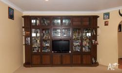 10 piece dark brown tv /wall units glass doors mirror