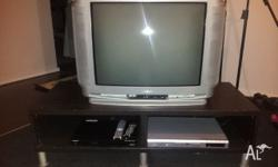 Tube style tv together with set top box, dvd player and