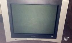 Older style TV with flat screen, comes with HD set top