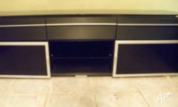 Satin Black with Glass top. 3 Draws and 2 compartment