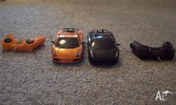Twin cars, one black, one orange, batteries not