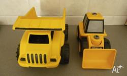 "Two Large ""CAT"" Trucks for Sale - $10 the Lot In very"
