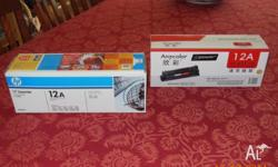 Two HP Q2612A toner cartridges. One is genuine HP and