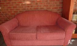 two seat sofa with wooden feat in very good condition