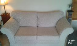 Two seater sofa as new. Still under warranty. Embossed