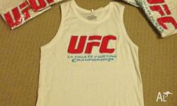 Up for sale are Brand New UFC Singlets White in color