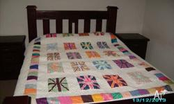 Home made Quilt for Queen size bed by a local artist.