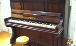 Upright Grand in good condition. Recently tuned. Ready