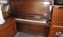 Faust brand piano, made in America. Has a steel frame.