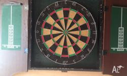 Offering a used dartboard for sale. Cheap, in good