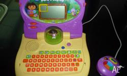 V-TECH DORA THE EXPLORER LEARNING LAPTOP This laptop