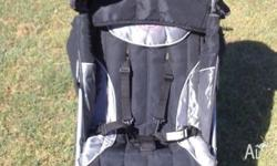 This barely used stroller comes with the following: -