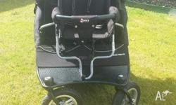 Twin pram with detachable toddler seat. Three years