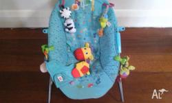 Vibrating bouncer chair with assorted clip on toys. In