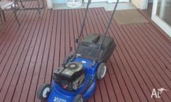Good condition 3.5hp 4-stroke motor, 18 inch cut,