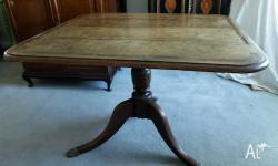This is a very useful oak Victorian dining table that