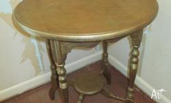 Circa turn of the century round side table. Turned legs