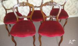 This set of four Walnut Dining Chairs are very