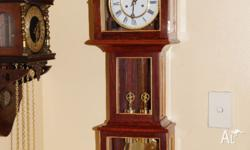 This is a beautiful solid Jarrah wall clock, in the