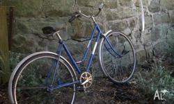 Vintage blue bike with brand new tyres that were fitted