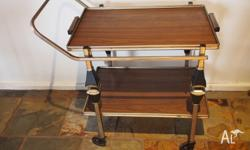 Beautiful retro drinks trolley with 2 removable trays.