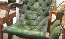 This is an old vintage green leather chesterfield style
