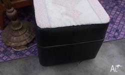 This is a vintage black leather ottoman/footstool/seat