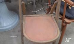 This is an old vintage wooden folding chair with orange