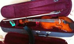 Childs 1/2 size violin with case ,bow & string wax in
