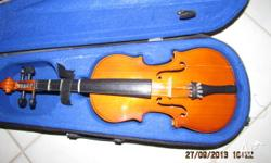 The violin comes with a bow and a case.