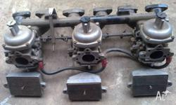 Complete set of triple Stromberg carbs for