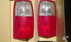 Pair of original tail lights. Drivers side has a small
