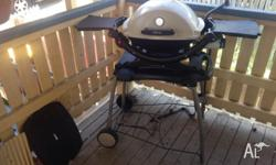 Used Weber Baby q 1200 Comes with the weber trolley /