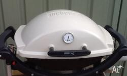 Near new Weber Baby Q BBQ, very little use, and so in