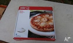 weber q pizza stone unused fits a 200 q not a 100q can