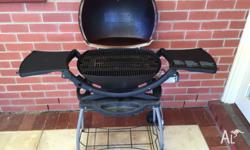 Weber Q 220 in reasonable (average) condition. Clean
