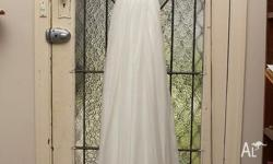 Beautiful size 6 white wedding dress. It is located in