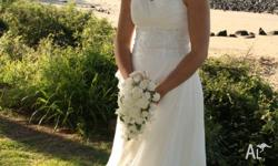 Size 10 Wedding dress only been worn once. Beaded at