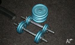 Weight bench, weights, barbell and dumbells in good