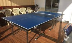 DONIC BRAND TABLE WITH NETS AND PADDLES, THE TABLE IS