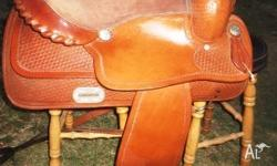 Brown western saddle has some marks around the horn,