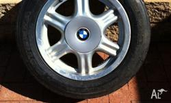 BMW or holden wheels and tyres. 205/60R15 Set of 4 Good