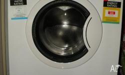 A Whirlpool washing machine, type WFE1070BD with 20