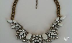 White and diamante bead crested choker statement