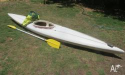 Light weight white sit in Tiger like fibreglass kayak