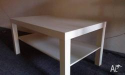 An Ikea-branded coffee table. Used, some minor