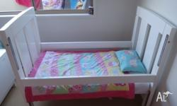 White Mali cot. No cot rails. Used as toddler bed. Good