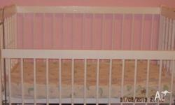 White timber cot, used condition. It does have teething