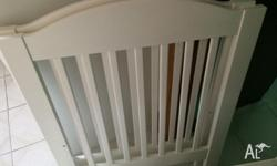 White timber cot with adjustable side and base. very