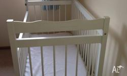 Beautiful white timber cot and mattress for sale. Great